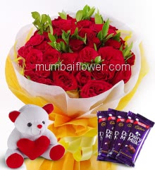 Bunch of 25 Red Roses nicely decorated with fillers ribbons and paper packing, with 6 Inch Teddy Bear and 5pc Cadbury Dairy milk of Rs.25 each