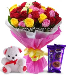 Bunch of 30 Mixed Color Roses nicely decorated with fillers and ribbons and paper packing, with 6 Inch Teddy and 2pc Cadbury Dairy Milk Silk of Rs. 60 each.