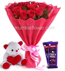 Bunch of 20 Red Roses with fillers Ribbons and Paper Packing, with a 6 Inch Teddy and 2cp Cadbury Dairymilk Chocolates
