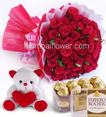 Beautiful Bouquet of 50 Red Roses nicely decorated with fillers ribbons and paper packing, with 6 Inch Teddy and Box of 16pc Fererro Rocher