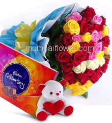 Bouquet of 50 Mixed Roses nicely decorated with fillers Ribbons and Paper Packing, with Box of Cadbury Celebration and 6 Inch Teddy