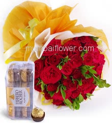 Hand Bunch of 25 Red Roses nicely decorated with fillers and ribbons packed with paper packing, with 16pc Fererro Rocher Chocolate Box.