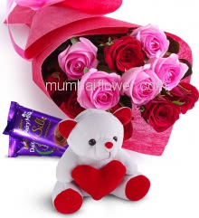 Beautiful Bunch of 12 Red and Pink Roses with fillers and ribbons packed with Paper Packing with 6 Inch Teddy and 2pc Cadbury Silk of Rs.60 each