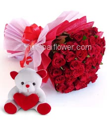 Beautiful Hand Bouquet of 60 Red Roses nicely decorated with fillers Ribbons packed with Paper Packing and 6 Inch Teddy.