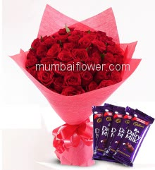 Bunch of 50 Red Roses nicely decorated with paper packing and ribbons and 5 pc Cadbury dairy milk