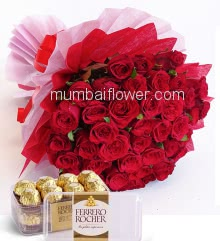 Beautiful Hand Bunch of 40 Red Roses nicely decorated with fillers and ribbons packed with Paper Packing and Box of 16pc Fererro Rocher Box.
