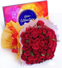 Bunch of 60 Red Roses nicely decorated with colored Paper Packing and ribbons and small Cad bury Celerbration Combo