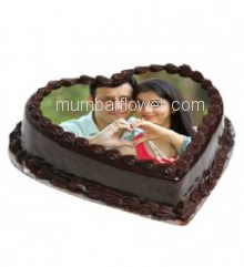 1 Kg. Premium Quality Heart Shape Chocolate Photo Cake, best in quality and taste... Order 24 hours in advance. Please note : Cake icing may differ from shown picture.