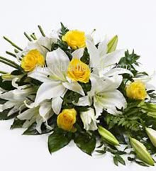 Basket Arrangement of 3 Lilies and 15 Yellow Roses nicely decorated with fillers and greens
