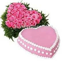 Heart Shape Arrangment of 50 Pink Color Roses and 1 Kg. Heart Shape Strawberry Cake.