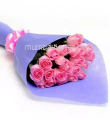 Hand Bouquet of 25 Pink Roses nicely decorated with ribbons and Color Paper Packing