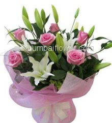 Hand Bunch of 6 Pink Roses and 2 Stems of White lilies nicely decorated with fillers and ribbons with Color Paper Packing
