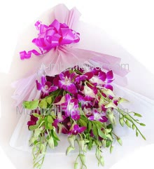 Hand Bouquet of 12 Stems of Orchids with fillers ribbons and Color Paper Packing