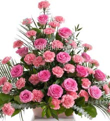 Arrangement of 25 Pink Carnations and 25 Pink Roses nicely decorated with fillers and greens