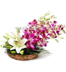 Arrangement of 5 Purple Orchids and 2 Lilies with fillers greens