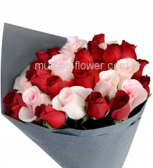 Hand Bouquet of 30 Red and Pink Roses nicely decorated with fillers and ribbons with Color Paper Packing
