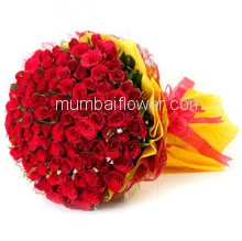 Hand Bunch of 150 Red Roses nicely decorated with fillers ribbons and Color Paper Packing