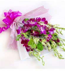 Bouquet of 15 Purple Orchids nicely decorated with fillers ribbons and color Paper Packing