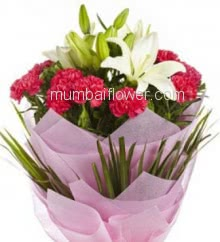 10 Red Carnation and 2 pc White Lilies with fillers ribbons and packed with Color Paper Packing