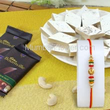 Box of Half KG. Kaju Katli and Small 2 PC bournville chocolate 31gm. with 1pc Rakhi, Bournville Raksha Bandhan Combo. Please note : Rakhi Design / Basket / Boxes /  Container may be replaced in case of unavailability/out of stock.