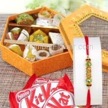 Box of 250 gm. Mixed Mithai and 3 PC KitKat Chocolate with 1pc Rakhi, Send this beautiful Gift Combo online. Please note : Rakhi Design / Basket / Boxes /  Container may be replaced in case of unavailability/out of stock.