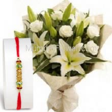 Bunch of 10 White Roses and 3 PC White Lilies with paper Packing and 1pc Rakhi . Please note : Rakhi Design / Basket / Boxes /  Container may be replaced in case of unavailability/out of stock.