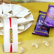 Box of 250 gm. Kaju katli and 2 pc mixed Cadbury Chocolate with 1pc Rakhi. Please note : Rakhi Design / Basket / Boxes /  Container may be replaced in case of unavailability/out of stock.