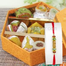 Box of 250 gm. Mixed Mithai with 1 PC Rakhi. Please note : Rakhi Design / Basket / Boxes /  Container may be replaced in case of unavailability/out of stock.