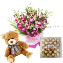 For your innocent love a beautyful Bunch of 10 Orchids and 24 pc Ferroro Rocher Chocolates with 12 inches cute Teddy